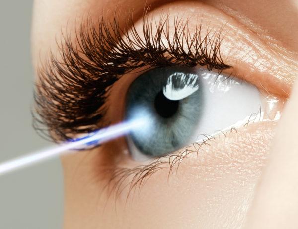 Laser vision correction. Woman's eye. Human eye. Woman eye with laser correction. Eyesight concept. Future technology medicine and vision concept