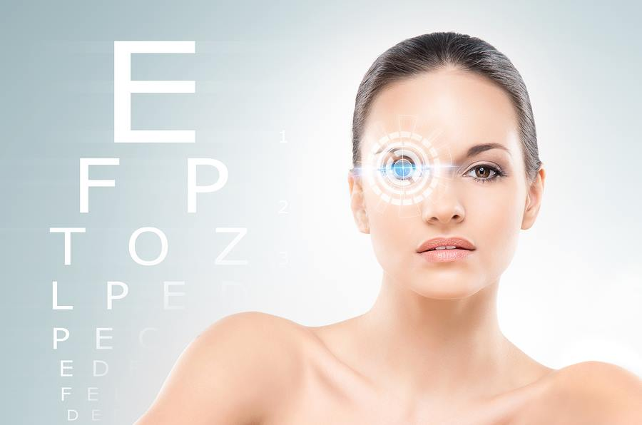 Beautiful woman with laser hologram and test vision table over c